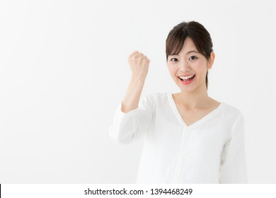 attractive asian woman cheering on white background