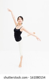 attractive asian woman dancing on white background
