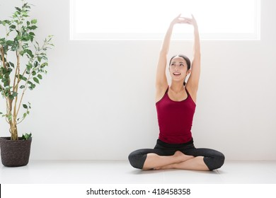 attractive asian woman exercising image