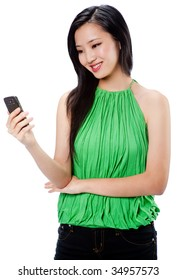 An attractive Asian woman in a green halter top with a phone on white background
