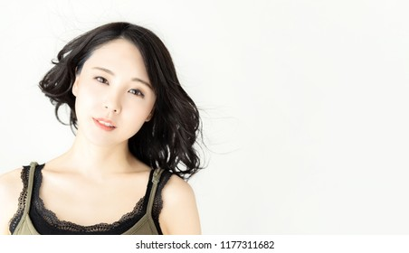 Attractive asian woman. Hair care concept.
