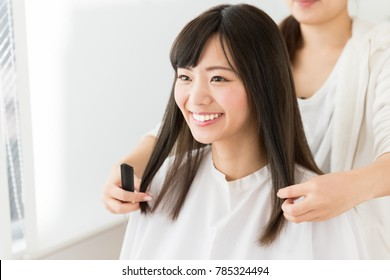 attractive asian woman in hair salon
