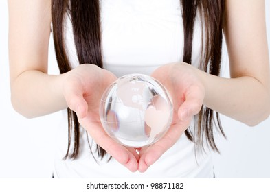 attractive asian woman holding earth crystal ball
