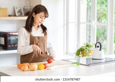attractive asian woman in kitchen