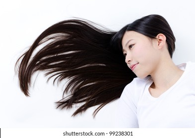 attractive asian woman lying with beautiful long hair