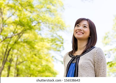 attractive asian woman in the park