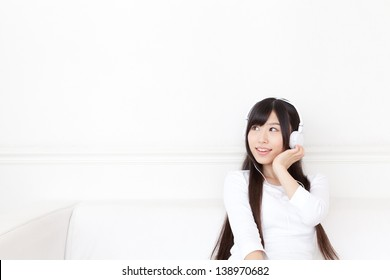attractive asian woman relaxing on the sofa