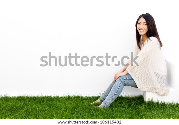 attractive asian woman sitting on white stair