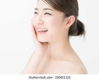 attractive asian woman skin care image on white background
