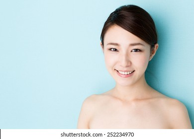 attractive asian woman skin care image on blue background