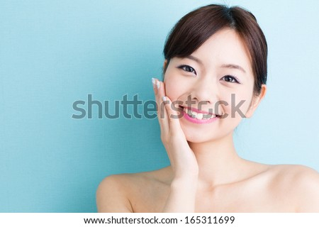 attractive asian woman skin care image isolated on blue background