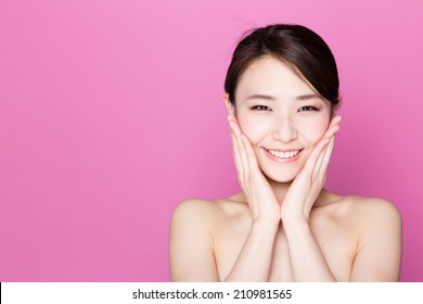attractive asian woman skincare image on pink background