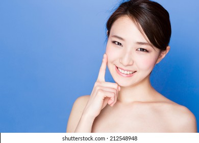 attractive asian woman skincare image on blue background