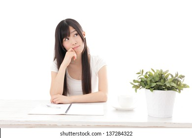 attractive asian woman studying on white background