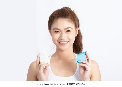 Attractive Asian woman using Facial oil clean film to removal oil and using tissue to removal toner on face for face fresh skin feeling so fresh and clean,Beauty Concept,Isolated on grey background