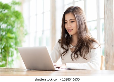 attractive asian woman using laptop computer