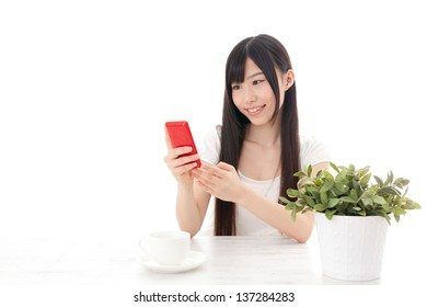 attractive asian woman using smart phone on white background