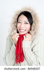 attractive asian woman warming myself
