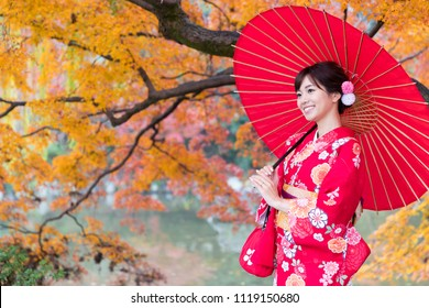 attractive asian woman wearing kimono in autumn