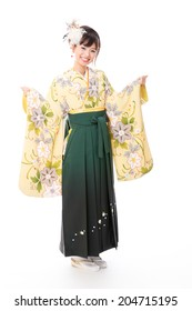 attractive asian woman wearing kimono on white background