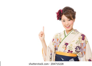 attractive asian woman wearing kimono on white background