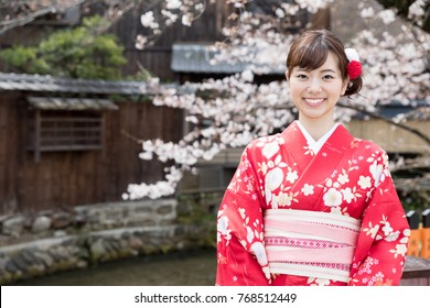 attractive asian woman wearing kimono in spring in kyoto