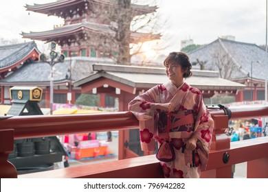 Attractive asian woman wearing kimono at Sensoji Asakusa Temple, Tokyo, Japan