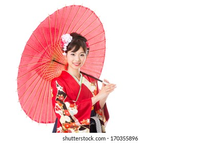 attractive asian woman wearing traditional japanese kimono on white background