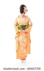 attractive asian woman wearing traditional kimono on white background