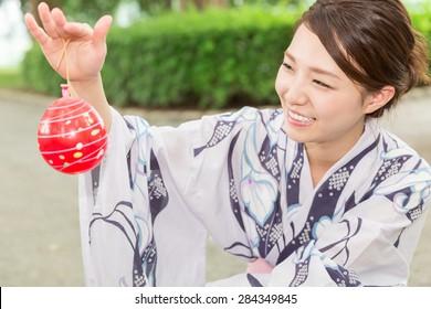 "attractive asian woman wearing traditional Japanese casual summer kimono called ""Yukata""."
