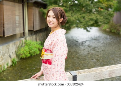 attractive asian woman wearing traditional Japanese Kimono