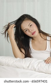 attractive asian young beautiful woman waking up in bed with refreshing.