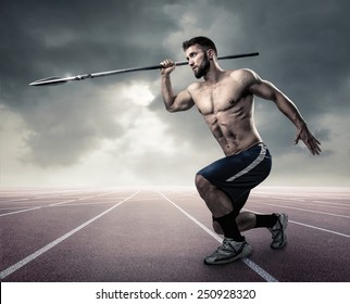 Attractive athlete with a spear