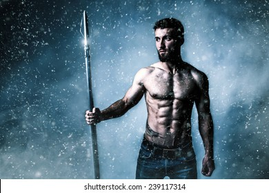 Attractive athlete with a weapon