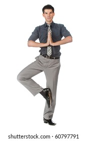 An attractive athletic businessman doing a yoga pose against white background
