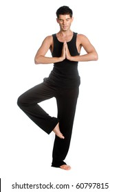 An attractive athletic man doing a yoga pose against white background