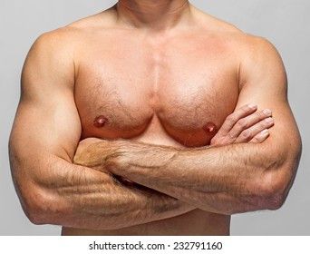 attractive athletic man on a grey background