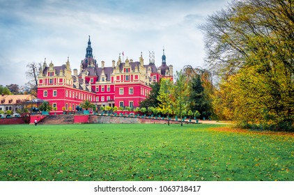 Attractive autumn view of Muskau castle. Rainy morning scene in Muskau Park, UNESCO World Heritage Site, Upper Lusatia region, Saxony, Germany, Europe. Traveling concept background.