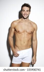 Attractive bare-chested male in underwear