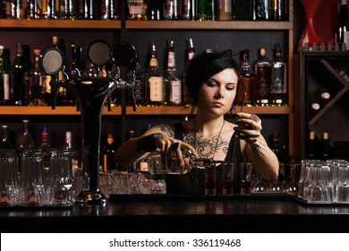 Attractive bartender with cocktail