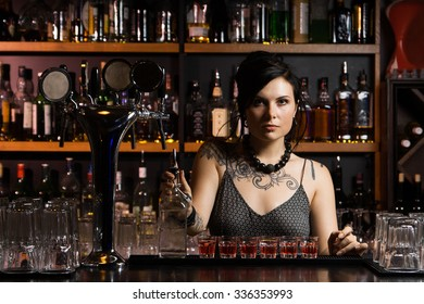Attractive bartender with drinks