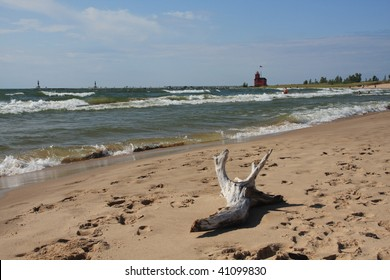 Attractive beach on the shores of Lake Michigan, with red lighthouse