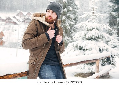 Attractive bearded man standing outdoors in winter