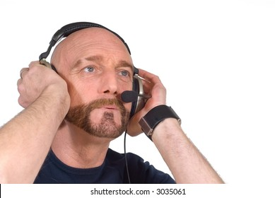 Attractive bearded middle aged man listening to music with headphones.