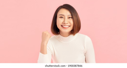 Attractive beautiful Asian woman hands up raised arms from happiness, Excited businesswoman winner success concept