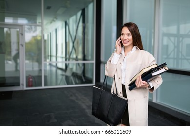 Attractive and beautiful businesswoman standing in office