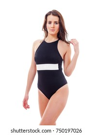 attractive and beautiful girl in a black swimsuit walking on white background