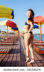 Attractive and beautiful girl in a swimsuit outdoor at summer time