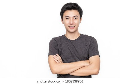 Attractive beautiful positive asian man - close up portrait of asian teenage man. Portrait of handsome nerd Japanese asia guy wearing t-shirt with big smile isolated on white background.