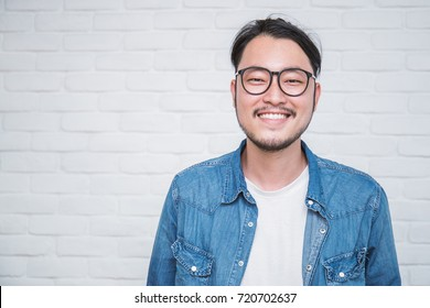 Attractive beautiful positive asian man - close up portrait asian nerdy man, social distancing. Portrait of handsome nerd Japanese asia guy wearing glasses with big smile isolated on white background.